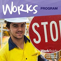 Works Program participant holds stop traffic bat