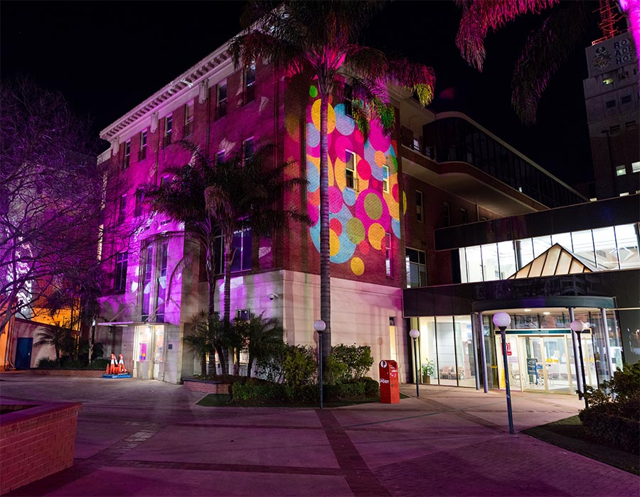 Allied Health building by night during LIT at Lot Fourteen