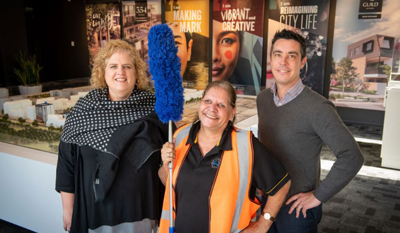 Renewal SA Works Program manager Samantha Wilson, Leanne Shearing from Zippy Indigenous Facilities Services and Renewal SA Project Director for Bowden Shane Wingard inside the Bowden Information & Sales Centre on Third Street.