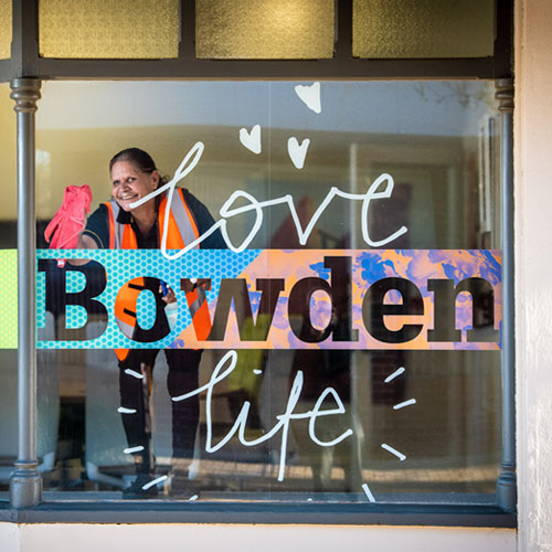 Leanne Shearing cleaning the window at Bowden's project office