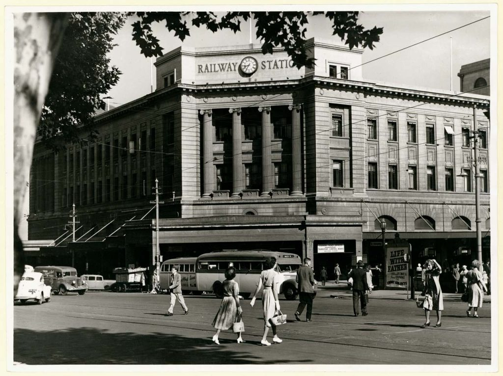 Pedestrians walking in front of the Adelaide Railway Station in the 1950s.