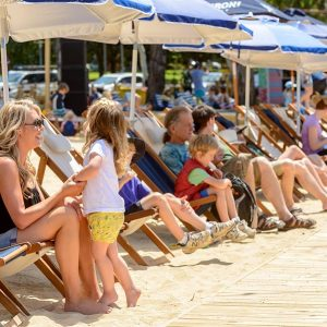 Urban Beach visitors relax in riverside deck chairs
