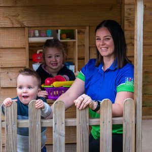 Stepping Stone employee Trista with two children