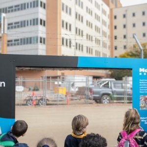South Australian school children who took part in a major World Environment Day 2019 event at Adelaide Botanic Garden (next door to Lot Fourteen) watching the demolition take place.