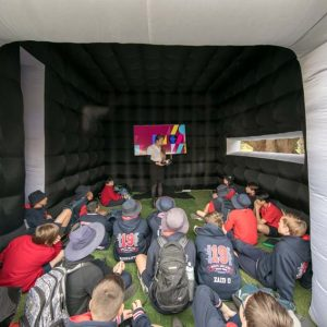 South Australian school children who took part in a major World Environment Day 2019 event at Adelaide Botanic Garden (next door to Lot Fourteen) watching a video to learn how Renewal SA recycles a hospital.