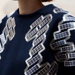 Navy-coloured shirt with solar panels sewn on